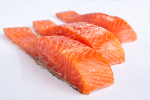 three salmon pieces on white background