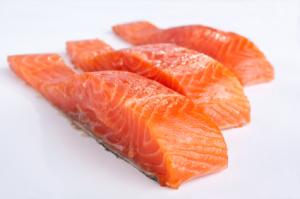 three salmon pieces on white background